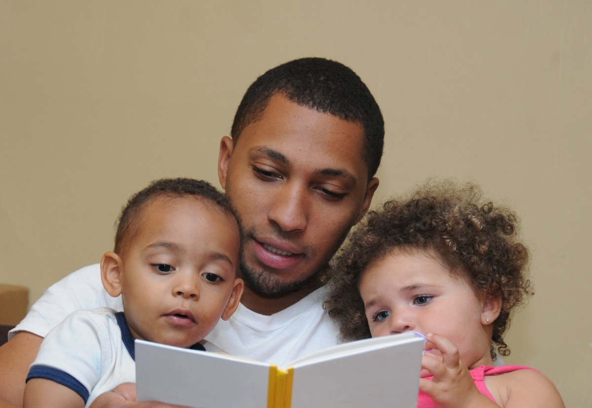 Father and children reading